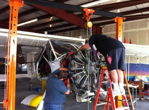 Richard Meyer and Paris Baird preparing to remove old AI-14 Engine.