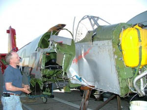 The late Gerry Beck looks over the Mustang's damage, summer 2004.