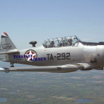Ret. Col. Harry Stewart (backseat) bring home the T6 he flew at Tuskegee Army Air Field (TAAF) in 1945