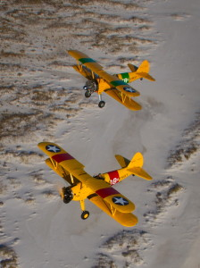 Stearmans 708 (Roy Kinsey) and 358 (Jerry Hedrick) over the beach at NAS Pensacola.