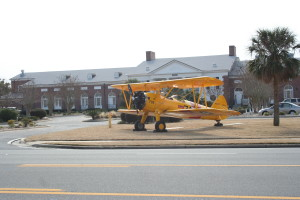 """Stearman 708 in front of the Mustin Beach Officers Club at NAS Pensacola for the opening celebration of the Centennial of Naval Aviation. After landing at Sherman Field it was towed to the """"O"""" Club for the party."""
