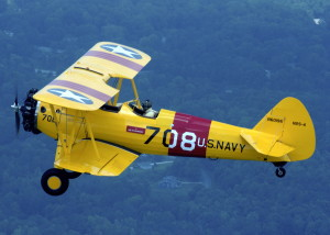 Stearman 708 flown by Roy Kinsey en route to Pensacola, Florida after completion of its restoration.
